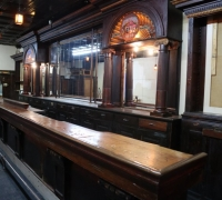 13A...1 OF A KIND ANTIQUE BAR W/CARVED LG. SHELLS...BACK BAR 24 FT. L....35 FT. L WITH 2 CABINETS....10 FT 10 INCHES H....FRONT BAR 31 FT LONG ...SEE 1159 TO 1178