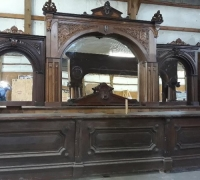 17D.....1 OF A KIND WALNUT CARVED BACK AND FRONT BAR 16' L X 11' H SEE 17E. 20B, 20C, 1279 TO 1286