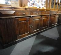 1112-antique-brunswick-back-bar-base-with-massive-columns-18-6-long