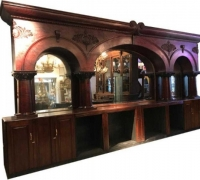 15.......BRUNSWICK ANTIQUE MAHOGANY BACK BAR ONLY....21' L X 11' H...C. 1880...SEE 1231 TO 1235 & 1258 TO 1261