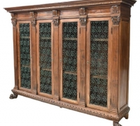 1746...WALNUT BOOKCASE WITH IRON DOOR PANELS....71.75 H X 97 W X 20.5 D