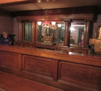 12 - 13 FT 4 IN. ANTIQUE BACK BAR X 8 FT 9 IN. H AND A MATCHING 14 FT LONG TO 23 FT LONG FRONT BAR - C. 1880 - see #1418 to #1429