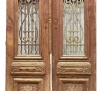 17A...CARVED WINGED ANGELS OVER IRON WINDOW INSERTS....109.5