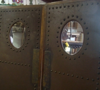 31-sold -antique-leather-and-brass-studded-doors