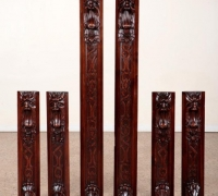 08f-six-carved-walnut-elements-with-faces-shorter-28-5-higher-52-25