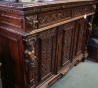 39-sold -antique-carved-figural-front-bar-short-sideboards