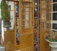 69- sold -great-antique-iron-and-stained-glass-elevator-with-iron-accordion-door-circa-1910
