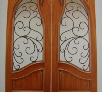 07-pair-of-new-carved-iron-and-wood-doors