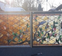 15a....98 IN. H X 37 IN W ANTIQUE STAINED GLASS WINDOW W/BIRDS